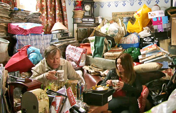 roy-and-carla-sit-amid-stuff