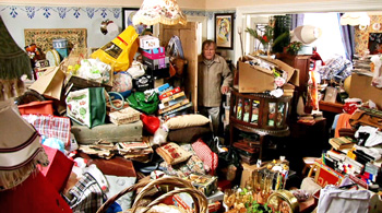 roy-enters-hoarding-house