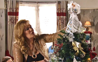 liz puts angel on tree