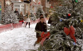 Corrie Christmas with people-coming-out-on-street