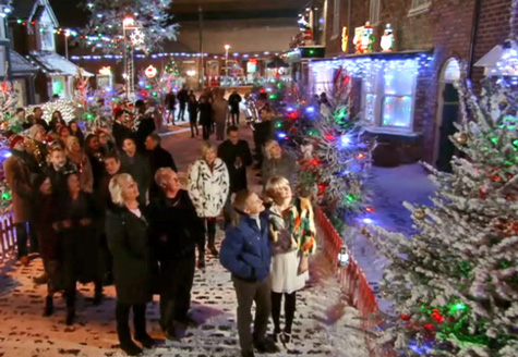 Corrie Christmas everyone on street-at-night