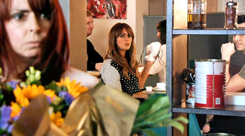 woman-holding-flowers as Maria and Pablo watch Luke leave