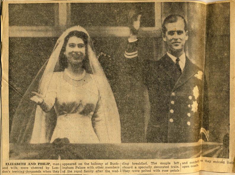 Elizabeth and Philip wave from Buckingham Palace balcony