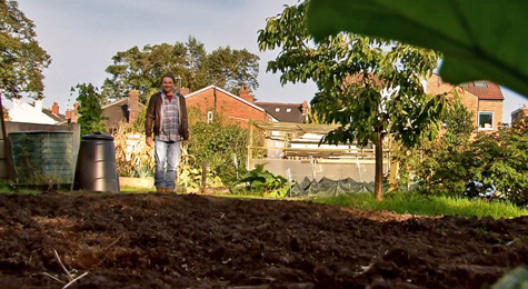Tim smiles at his fully dug up garden plot