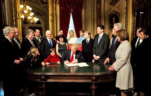 Trump_first_day_as_President signing orders and nominations-wikipedia