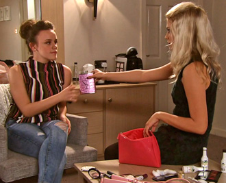 Bethany hands flask to Faye
