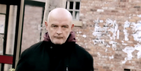 Phelan on street looking angry