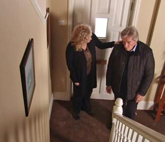 ken looks at stairway