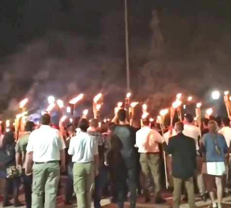 crowd with torches around robert e lee statue