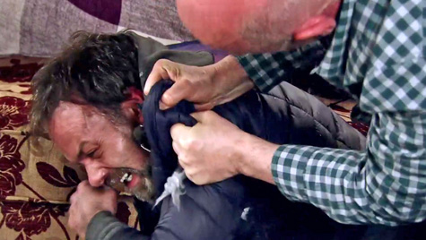 Phelan holds billy down and tells him he is a junkie